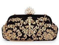 Dolce & Gabbana clutch in oro con chiusura gioiello
