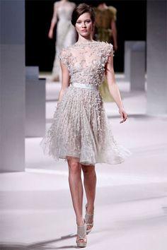 Short Feminine Wedding Dress: Photo by This is Glamorous via Kelly Oshiro.