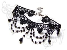 Victorian Gothic Black Lace Choker Necklace & Earrings Jewelry Set with Dangle Crystals. $34.90, via Etsy.