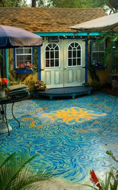 "Idea for painted cement, looks like water to me. Original Description: ""Art studio and painted cement patio. Painted Cement Patio, Concrete Patio, Painted Floors, Concrete Floors, My Art Studio, Dream Studio, Outdoor Projects, Home Projects, Bungalows"
