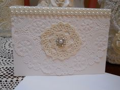 Baker's doily Handmade Greeting Card for all occassions, white heavy card stock, cream, white, ivory,Bakers Doily,Pearls, bling, vintage lace, blank inside with matching envelope. Will be send in protective Cellophane sheet. This card has a lil ding on one corner, it is fixed, but therefore the reduced price. Give for birthdays, special holidays, friendship, teacher's …