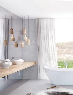 With its bleached woods, pale, neutral colours, this style has a clean, airy feel — perfect for those who want their bathroom to be an oasis of tranquillity. The simple, pared-back Scandinavian look is all about editing — with minimal decoration. Design interest comes from the beautifully balanced Caroma Cupid Freestanding Bath and the naturally occurring textures of wood and hard materials.