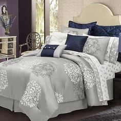 I love this silver bed set! (without the blue accent pillows or the floral sheet set)