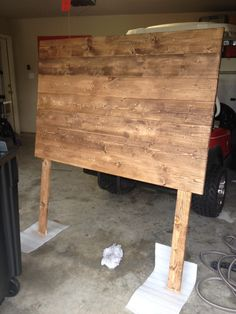 "DIY (full size) headboard.  7 - 1x6x6 boards from Lowe's 2 - 1x4x6 boards from Lowe's  Minwax stain in ""special walnut""  Screw 1x6x6 boards across into the 1x4x6 as legs.   Sand.   Wipe Down.   Stain.  <3"