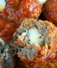Recipe for Mozzarella Stuffed Meatballs - These meatballs are amazing! I don't make them often enough but am always so glad when I finally do. They are great on top of spaghetti and they also make fantastic meatball hoagies!