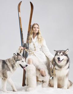 Ermanno Scervino polyester and duck down jacket, £1,680, and Mongolian goat shearling skirt, £2,020. Moncler faux fur and leather boots, £1,030. Dogs wear: Mungo & Maud rope and leather collars, £55 each, and matching leads, £70 each
