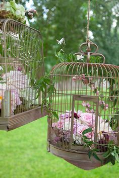 love the idea of bird cages with little flowers, or other decorative items inside. AMAZING!