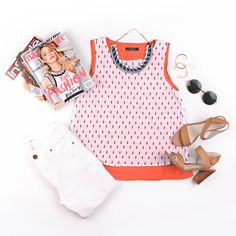 This flatlay features a printed sleeveless top with white jeans, minimal leather heels, and round sunglasses for the perfect summer look!