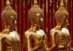 Three statues near Chiang Mai, Thailand | iExplore