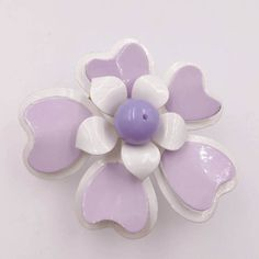 Check out this item in my Etsy shop https://www.etsy.com/listing/517660009/two-tone-lavender-white-flower-pin-1960s