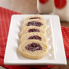 PB&J Shortbread Cookies: Tender peanut butter shortbread cookie recipe filled with grape jelly and sprinkled with confectioners' sugar