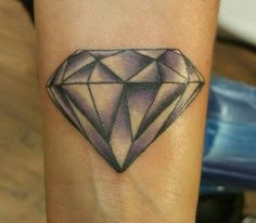 Diamond tattoo on left wrist