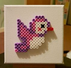 A lovely picture of a bird made from Hama beads, mounted on a white canvas. The canvas is 4x4 and can be wall mounted or freestanding. Made to a very high standard, Please see other listings for alternative designs.