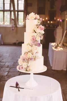 A gorgeous four tier buttercream iced wedding cake with a stunning cascade of fl. A gorgeous four tier buttercream iced wedding cake with a stunning cascade of flowers by Clare Lee. 5 Tier Wedding Cakes, Buttercream Wedding Cake, Floral Wedding Cakes, Elegant Wedding Cakes, Cool Wedding Cakes, Beautiful Wedding Cakes, Wedding Cake Designs, Wedding Cake Toppers, Blush Pink Wedding Cake