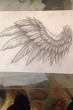 Wing design tattoo