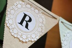 Homemade Happy Birthday pennant banner with doily and printed letter glued to it (spa themed party)
