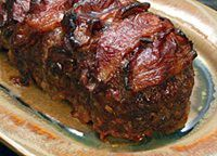 Bacon-Wrapped Meat Loaf With Barbecue Sauce Glaze- This delicious bacon-wrapped meatloaf is enhanced with grated natural Parmesan cheese, Cajun spices, and a tasty barbecue sauce glaze. Take a look at the large photo of this meatloaf.