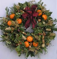 Christmas door wreath I love the additon of clove studded clementines - it will not only look good but there will be a welcoming fragrance for my guests @TopCashback