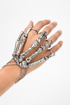 Bjorg Grip Hand Piece - this was available online at Urban Outfitters.  It's just crazy looking enough for me to want it.  Me and my bizarre jewelry fetish.