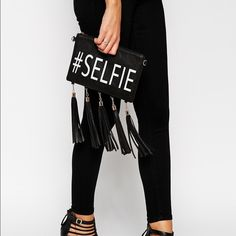 #Selfie clutch by Kissme Couture, sold on Aldo. It is in excellent condition, no tears or anything like that. Very soft to touch. Easy to style. Bags Clutches & Wristlets