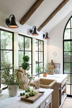 Modern farmhouse kitchen with rustic French cutting boards and French windows.
