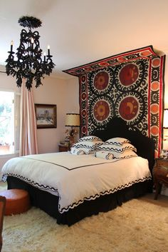 Ok, so the actual items here are too dramatic for me, but the IDEA of a rug as a canopy/headboard with a coordinating chandelier NOT right over the bed appeals to me.