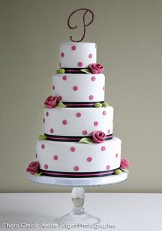 Delightful Rosebud and Polka Dot cake from Layers Wedding Cakes - http://www.layersweddingcakes.com/index.php?option=com_content=view=25=56=1=1#