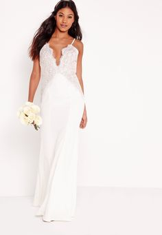 Sh*t just got real with the new bridal collection from Missguided.  Lace be honest, if minimal vibes are your thing then this simple all-white fabric with a lace overlay is the dress to say yes to. Make your groom cry with this floor-swee...
