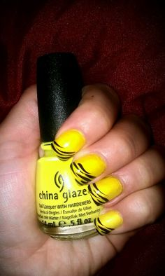 Yellow nails with black zebra design!