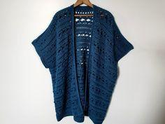 Water's edge kimono in Caron yarn in the color ocean. kimono on hanger