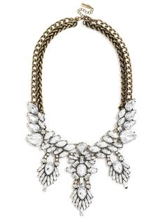 This stunning bib has lots of movement--fringe detail adds drama to the silhouette, while light-catching crystals come together in an ornate marquise-lined collar.
