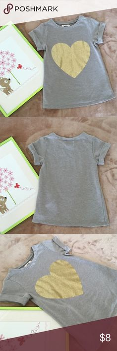 Girl's Old Navy Heart Shirt Dress Comfy & soft, rolled up short sleeves with a glittered heart in the middle. Tunic length, perfect to wear with leggings. 58% cotton, 38% polyester & 4% spandex. In good condition, shows normal wear & tear. No known holes or stains. From smoke & pet free home. (DR2) Old Navy Shirts & Tops Tees - Short Sleeve