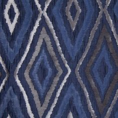 Diamonds with a wavy, ikat-like effect adorn this polyester home decor fabric. Has a sheen and texture like silk dupioni; very elegant. Applications: bedding, light upholstery, window treatments and accent pieces.