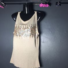 Gorgeous tank top Gorgeous tank blouse. Gold w/ lots of gems on the chest - None missing - stretch material ..like new condition. Tops Blouses