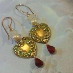 gold,brass heart ,moonstone,pearls and jasper.