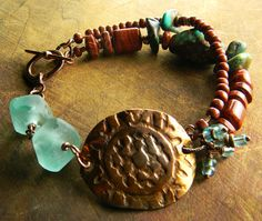 Desert red and cool aqua compliment the copper focal in a bracelet by Gloria Ewing on Etsy.
