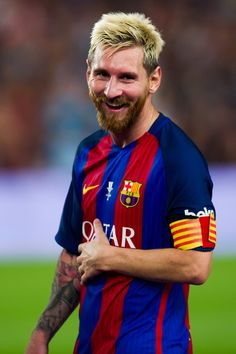 Lionel Messi of FC Barcelona laughs after the Spanish Super Cup Final second leg match between FC Barcelona and Sevilla FC at Camp Nou on August 17, 2016 in Barcelona, Catalonia.