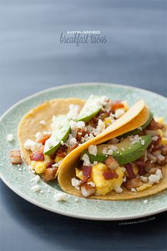 Austin-Inspired Breakfast Tacos with potato, egg, bacon, avocado, and cotija cheese are perfect for breakfast OR dinner.