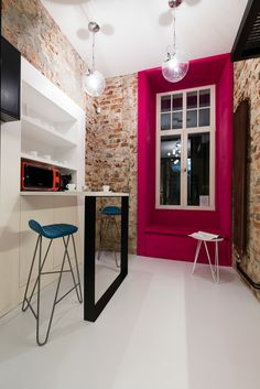 Office, Red brick, white floor, pink accent.