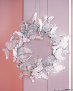 DIY butterfly wreath. so pretty I'd never take it down.