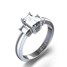 1 1/2 ctw Three Stone Emerald Cut Diamond Ring in Platinum