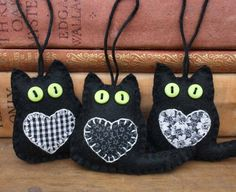 Black felt cat ornaments, Black cat ornaments, Lucky black cat, Good luck gift, Handmade felt cats, Halloween cat ornaments, Good luck token by PuffinPatchwork on Etsy https://www.etsy.com/listing/196923654/black-felt-cat-ornaments-black-cat