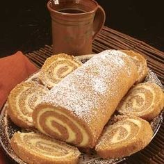Pumpkin Rolls  3 Eggs  1C. Sugar  2/3 C. Pumpkin (1 Large can of Pumpkin yields 5 pumpkin rolls)  1 tsp. Lemon Juice   C. Flour  1 tsp. Baking Powder  1 tsp. Salt  1 tsp. Nutmeg 2 tsp. Cinnamon  1/8 tsp. Ground Cloves   tsp. Allspice    Preheat oven to 325. Put waxed paper on cookie sheet. Butter/spray lightly.  (I measureout all of the dry ingredients-except for the sugar- in one bowl to dump in all at once while mixing-makes things go more smoothly