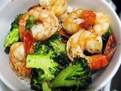 Roasted Shrimp & Broccoli  1. Heat the oven to 425.  2. On a large cookie sheet, toss together 2 pounds of broccoli cut up into florets (but not teensy tiny florets, I like a little stem attached), 2 Tbs olive oil, 1 teaspoon whole coriander seeds (or 1/2 tsp. ground), 1 teaspoon whole cumin seeds (or 1/2 tsp. ground), 1 tsp salt, 1/2 tsp pepper and 1/8th tsp hot chili powder. Spread into a single layer and pop into the oven for 10 minutes.  2. Meanwhile, toss together one pound