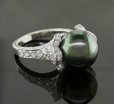Green pearl engagement ring