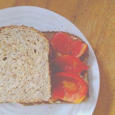Tomato and hummus sandwich on Ezekiel Bread!
