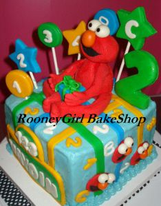 The special cupcake with an Elmo candle for the birthday girl to