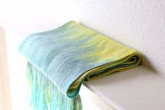 """<p>Hand woven long scarf with gradually changing colors from yellow to green and blue.</p> <p>Measures: <br>L: 78"""" with 6"""" fringe on both ends W: 11""""</p> <p>Care instructio... #kgthreads"""
