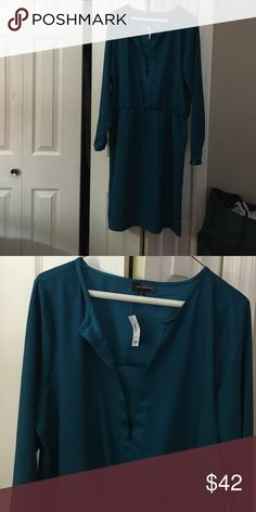 NWT the Limited teal silk dress NWT!! Easy elegance, wear with sandals and dress down or dress up with jewelry! Cinched at the waist this is an XL tall size. The Limited Dresses