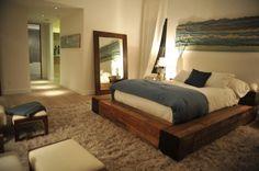 platform bed, large mirror, plush rug